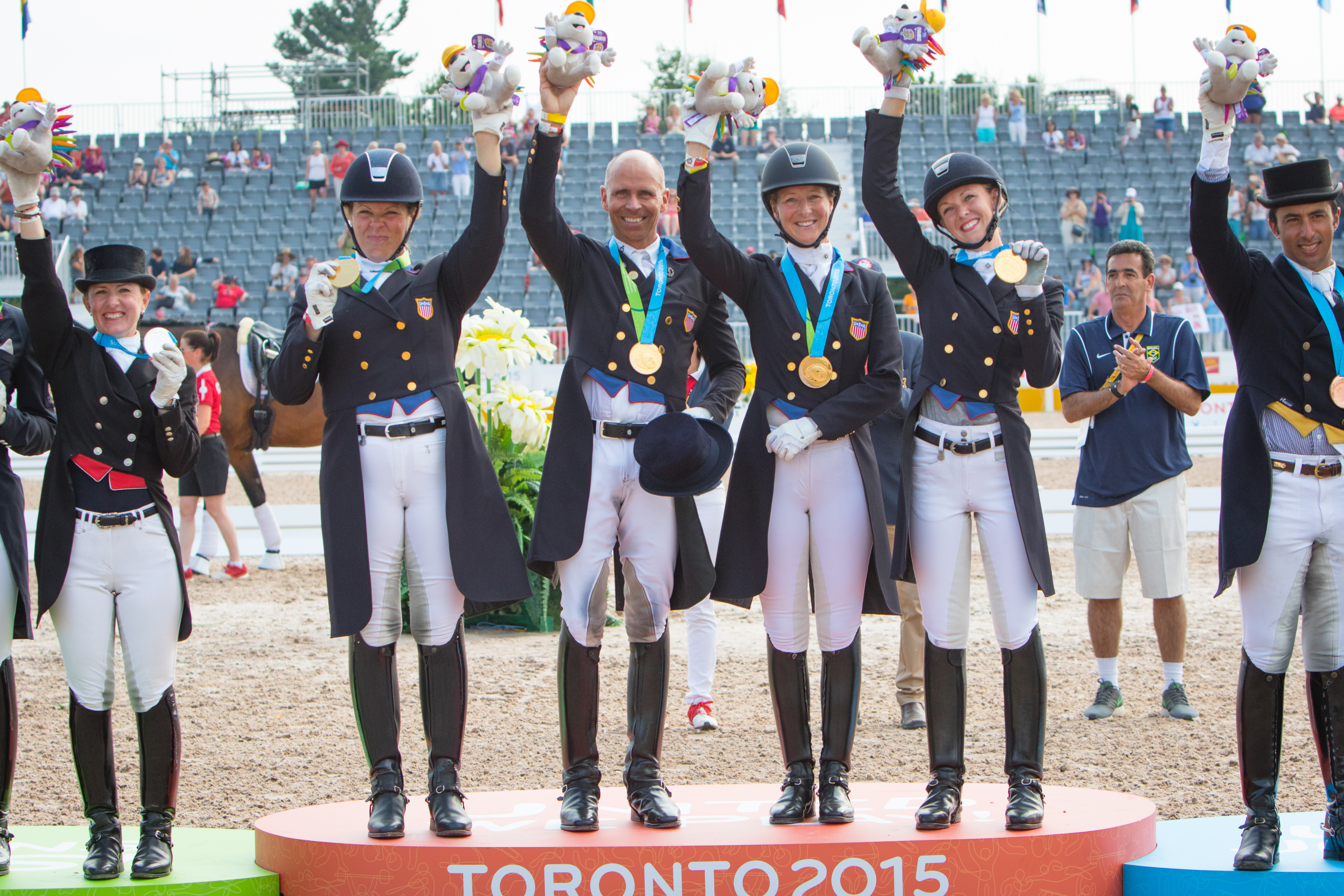 US Gold Medal Team, Kimberley Herslow, Steffen Peters, Sabine Schut-Kery and Laura Graves on the podium at the OLG Caledon Pan Am Equestrian Park during the Toronto 2015 Pan American Games in Caledon, Ontario, Canada. Pic StockImageServices.com